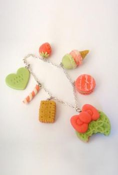 Sugar and spice and everything nice. This unique bracelet is decorated with molded polymer clay cookie sandwiches, macarons, cupcakes, you name it. All the best sweets found on one adorable bracelet. bracelet. Be ready to get compliments everywhere you go! Can also be doubled as a purse charm!    $26 at https://sincerelysweetboutique.com/node/154