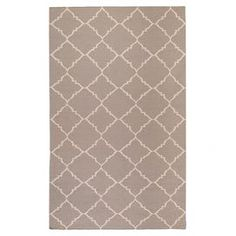 Wool flatweave rug with a trellis motif. Handmade in India.    Product: RugConstruction Material: 100% WoolColor: Dark taupe and feather grayFeatures:  Hand-wovenMade in India Note: Please be aware that actual colors may vary from those shown on your screen. Accent rugs may also not show the entire pattern that the corresponding area rugs have.Cleaning and Care: Blot stains