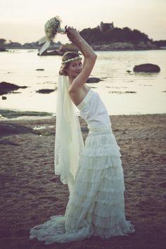 I love this drop waist ruffled wedding dress!  Very boho. Cute flower head band with a simple veil.