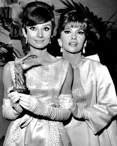 Quality and quantity. Audrey Hepburn & Gina Lollobrigida at the Marigny Theatre during the Nuit du Cinema, Paris, October 29, 1965.