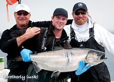 Brotherly luck!  Family day of fishing yields another large Chinook salmon, Naden Harbour, British Columbia.