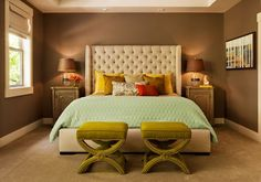Eclectic bedroom interior design with reddish accents