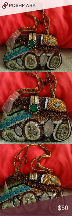 Unbranded flawless detailed Beaded W/ Stones Bag This is a brand new unbranded Flawless and very detailed beaded with stones small evening bag. This has all different style stones and colors and is extremely detailed. This has double gold braided thin straps with flowers and hanging beads on parts of the straps. The green stone with the clear Stones around the front is the snap opener to get inside the bag. Once inside the bag are two larger compartments and a middle zippered compartment…