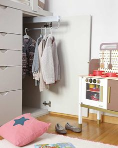 In a small room it is important to utilise the available space as much as possible. The loft bed allows for drawers and a closet underneath with a pullout rail for easy access. This allows the full depth (just under a meter) to be fully used.