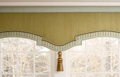 Pelmet or cornice with banding and tassel accent. Available DesignNashville