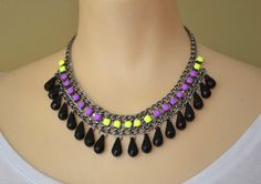 neon jewelry painted rhinestone necklace Colorblock purple yellow. $38.00, via Etsy.