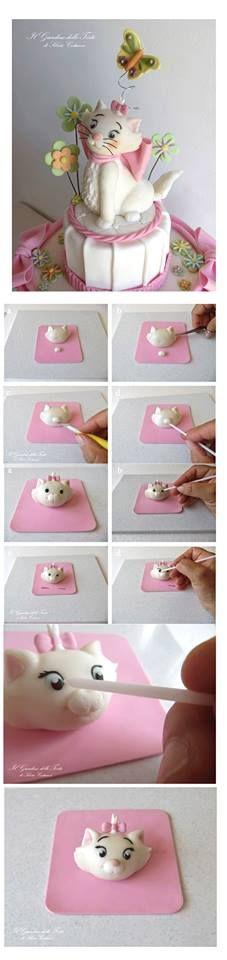 http://cake.corriere.it/2013/07/31/topper-minou-gattina-degli-aristogatti-tutorial/