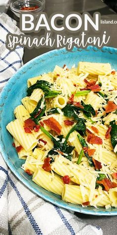 Bacon and spinach surround the rigatoni pasta and are seasoned with spices and Parmesan cheese. A perfect weeknight pasta recipe idea.
