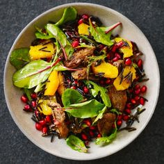 spiced duck breast with orange and pomegranate wild rice salad