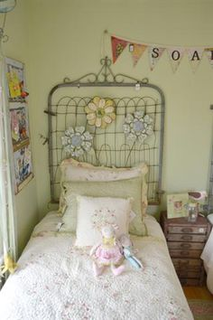LOVE LOVE LOVE! Vintage garden gate used as a headboard in the twin girls' garden-inspired bedroom at the Bachman's Ideas House