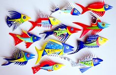 http://www.plastiquarium.com/plastiquarium/gallery_images/Fish_Pins.jpg - fish pins made from laundry detergent bottles!  LOVE!