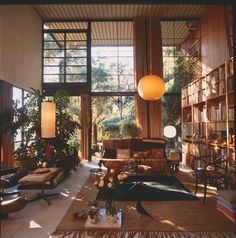 Stunning midcentury living room with floor to ceiling windows.