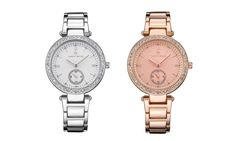 Be fashionably on time with this elegant quartz watch which sports a dial embellished with multiple shimmering crystals