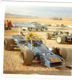 1975 photo Emmett Id. Super Oval, Dan Hoffmans rear engine and the famous front wheel drive car on the right.
