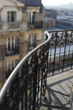 A quiet afternoon on a Paris balcony, enjoying the smell of baking bread on the breeze and the feel of the sun on your back as you relax and enjoy a good book.