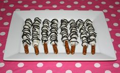 day 64: baking away/ chocolate and caramel zebra pretzels for our Minnie Mouse birthday, Valentine's day, or any day!! Plus easy diy place cards for your dessert table