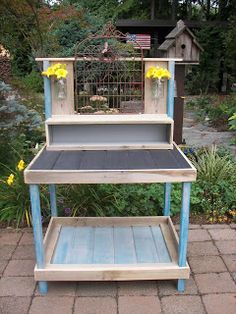 Kids potting bench/craft table from recycled fence boards and pallets - complete with mounted jars to store treasures and a chalkboard top for personalizing!