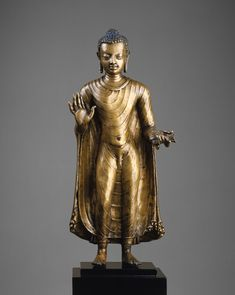 Buddha    Period: Gupta period  Date: late 6th–early 7th century  Culture: India (probably Bihar)  Medium: Bronze  Dimensions: H. 18 1/2 in. (47 cm); W. 6 1/8 in. (15.6 cm); D. 5 5/8 in. (14.3 cm)  Classification: Sculpture