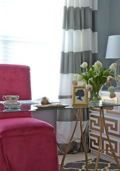 Beautiful desk decor, pink parsons chair, and grey walls. Love the striped curtains.