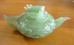 "A wonderfully carved DRAGON jade teapot. This is a very high quality green jade with exquisite carving. The lid is a traditional classic dragon head. Slightly more than10"" across and 4 1/2"" high. Nicely polished. Ying Yu Jade exclusive."