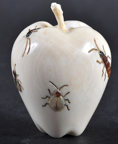 A JAPANESE SHIBYAMA INLAID IVORY FRUIT decorated with insects. 2.25ins high.