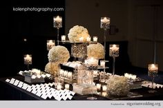 "Jazzi Events: "" I love this black and white escort table set up. It gives such a simple yet elegant look to any wedding!.""  Staci A. Lewis"
