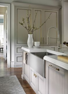 """House Beautiful Magazine's Kitchen of the Year Kitchen, featuring DXV Hillside 36"""" Sink in Stainless Steel and GROHE Pull-Down Faucet. Designed by Matthew Quinn."""