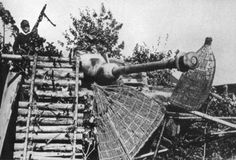 A cleverly camouflaged StuG III Ausf. G in a village somewhere in the Duena River area near Riga Sept. 1944. It is equipped with the 'Saukopf' gun mantlet, but features only a hand-held infantry MG42 in place of the remote-controlled machine gun mount fitted to an armored shield