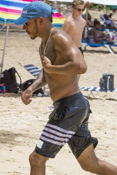 Lewis Hamilton wearing Thom Browne Striped Long-Length Swim Shorts and Beloved Denim Hat