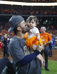 Houston Astros second baseman Jose Altuve (27) kisses his daughter while celebrating the Astros 4-0 win over the Yankees in Game 7 of the ALCS at Minute Maid Park, Satuday, Oct. 21, 2017, in Houston. Photo: Karen Warren/Houston Chronicle