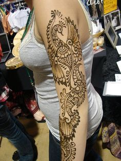 mehndi like peacock tattoo