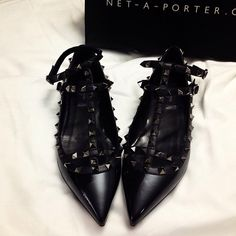 All-black Valentino rockstud flats