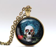 Funky skull charm. Anatomy jewelry. Creepy chain.    Handmade pendant necklace, comes in bronze or silver finish, on a chain or a leather cord.