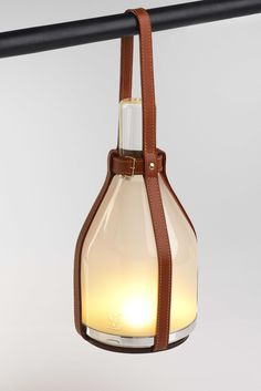 """Louis Vuitton """"Objets Nomades"""" - A bell lamp by Barber & Osgerby."""