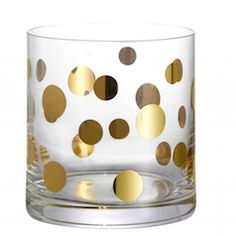 Brighten up your kitchen with this fun gold polka dot glass