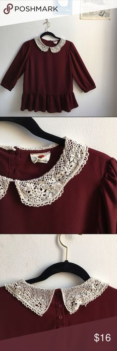 Peplum Lacey Peter Pan Collar Blouse This maroon Blouse is so sweet - the Peter Pan Collar of lace is dreamy, and the peplum and loose fit is absolutely flattering. While the colors scream fall and winter, the lightweight material (100% polyester) is breezy. Small button closures at the nape of the neck and end of blousey 3/4-length sleeves. Tops Blouses