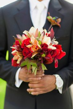 overall great mix of red, green, cream flowers and texture for this bouquet!