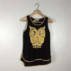 New Owl Tank Top, By Ya, Size S New tank top by Ya, featuring a gold embroidered and sequined owl on the front, and gold trim.  Really cute!  Front is shorter than the back.  100% polyester. Ya Los Angeles Tops Tank Tops