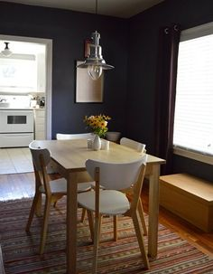 Dark walls in a simple dining area--chairs are so cool. WHERE?