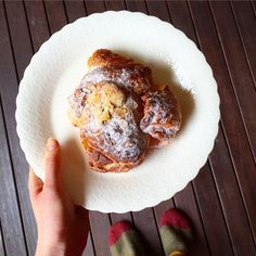 """Instagrammer wayfaringchocolate shared this photo of an almond croissant she discovered in Canberra: """"It's totally okay if you're more envious of my awesome sock-slipper-things than the ginormous almond croissant I'm devouring."""" #fromwhereistand #visitcanberra"""