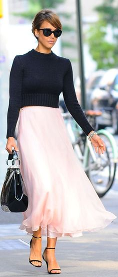 Jessica Alba in a cropped sweater and flowing skirt