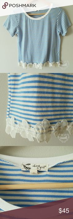 Flower trim ringer tee Blue and white stripe short sleeve ringer tee with flowers on bottom. No damage, soft material! Similar to brandy melville tees About A Girl Tops Tees - Short Sleeve