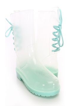 Be comfy yet adorable this season with these jelly rain boots! They will go perfect with your favorite dress or skinnies! Make sure you add these to your closet, it definitely is a must have! The features include a clear rubber upper with a back lace up tie design, round closed toe, rubber traction soles, smooth lining, and cushioned footbed. Approximately 12 inch circumference and 8 1/4 inch shaft.