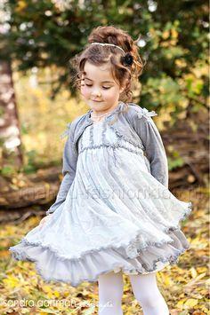 Little girl in grey dress