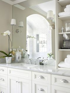 Clean white on white bathroom. Love the decor ideas and shelving. Traditional stle. (69)