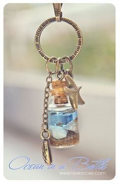 Ocean in a Bottle necklaceglass bottle with Shells by 13thPsyche