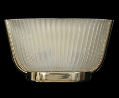 Torche   R149 (Shown in Polished Brass finish) French Deco-style wall light. Ribbed, satin cast glass shade and cast brass frame.
