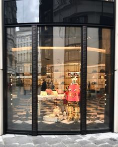 Robot in the window display of PRADA. Winter 2017. Austria, Vienna