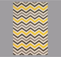 Ahhh...never tired of chevron, I love this tri-color area rug.  Its a bit too pricey but I think i can recreate it with fabric paint and stencil?