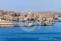 Lüderitz is a harbour town in southwest Namibia, lying on one of the least hospitable coasts in Africa. It is a port developed around Robert Harbour and Shark Island Shark, Facade, Dolores Park, Coast, Africa, Island, Stock Photos, City, Travel